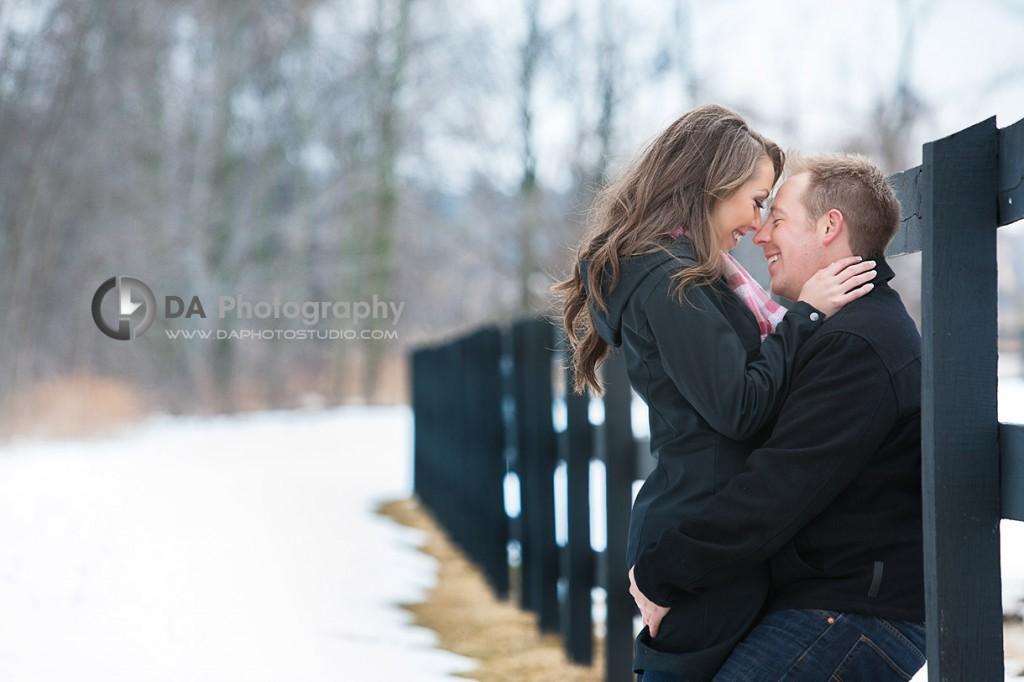 A kiss by the fence - Romantic engagement photos by DA Photography at Parish Ridge Stables in Burlington , www.daphotostudio.com