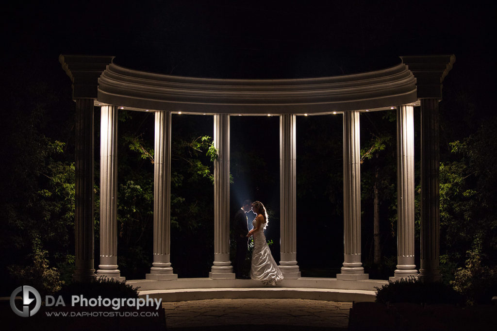 The kiss by the pillars at Paradise banquet hall on a Modern Italian Wedding