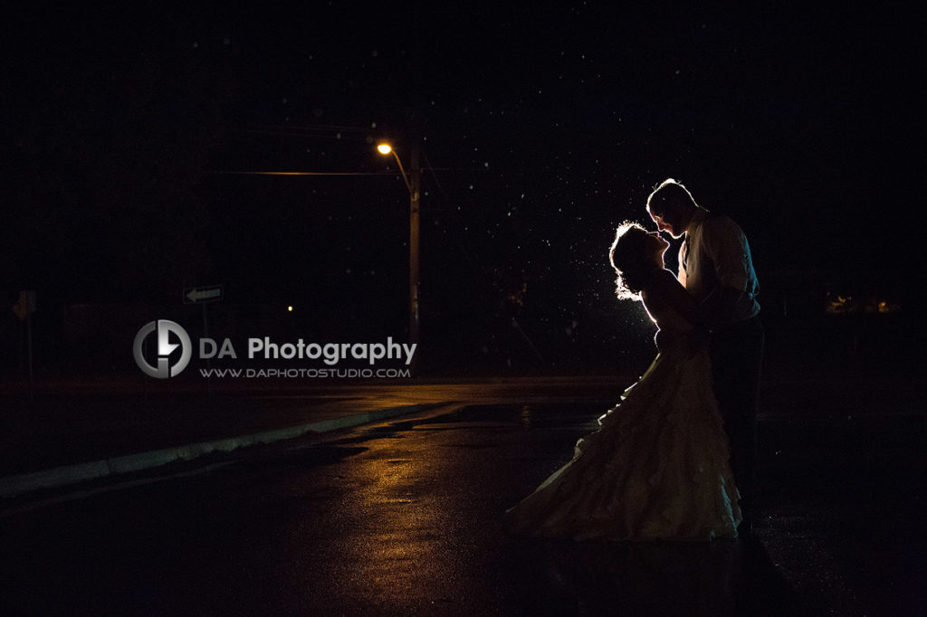 Bride and Groom Kiss under the open rainy sky at Weddings in Port Dover
