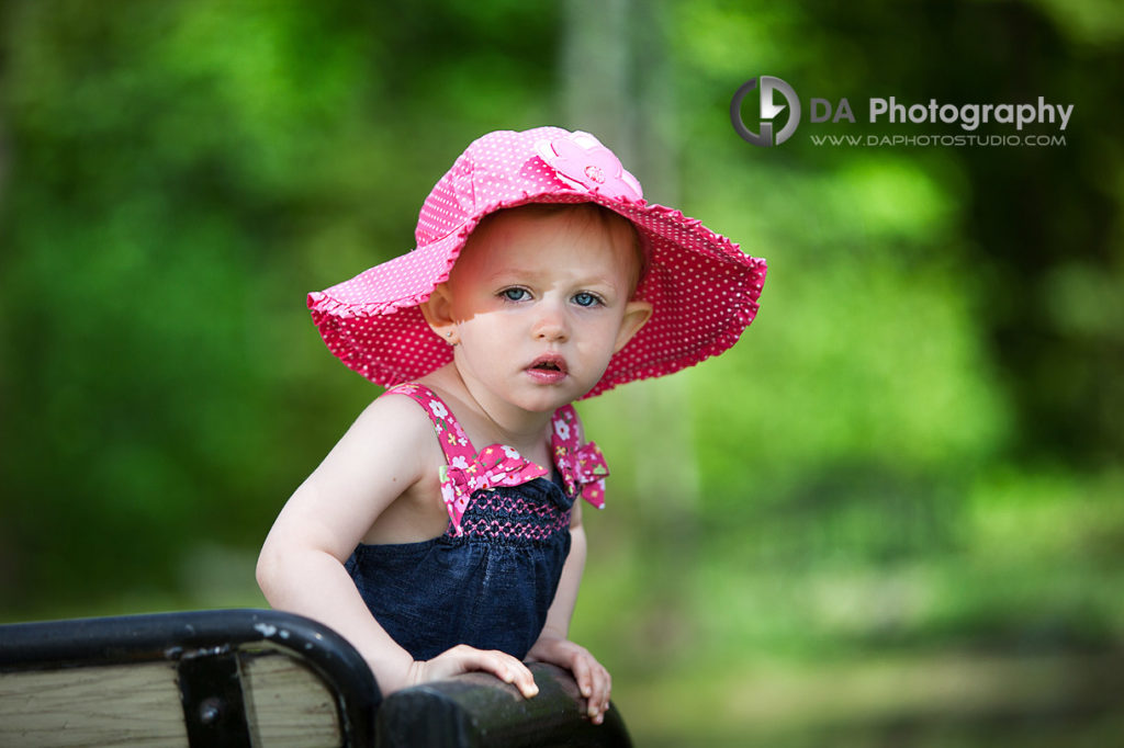 Little girl with her colourful hat and her blue eyes - Outdoor Photo Shoot by DA Photography, www.daphotostudio.com