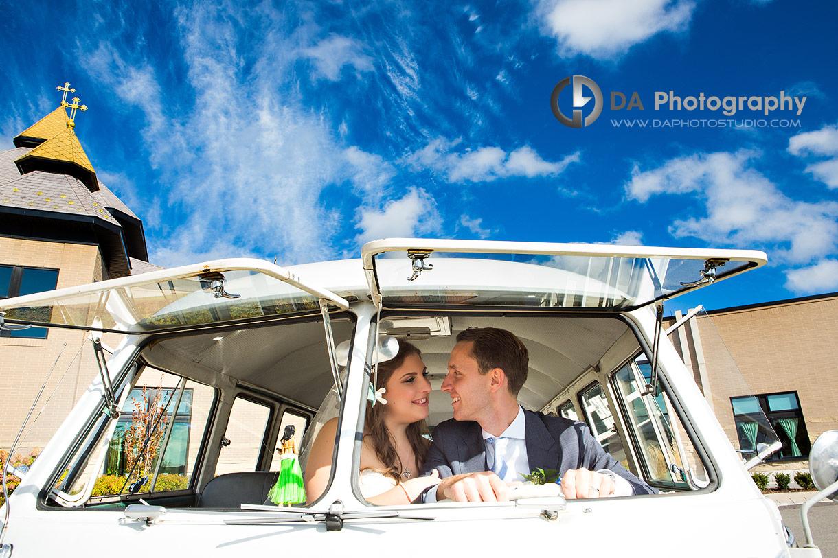 Wedding Picture of Bride and Groom in vintage Volkswagen van