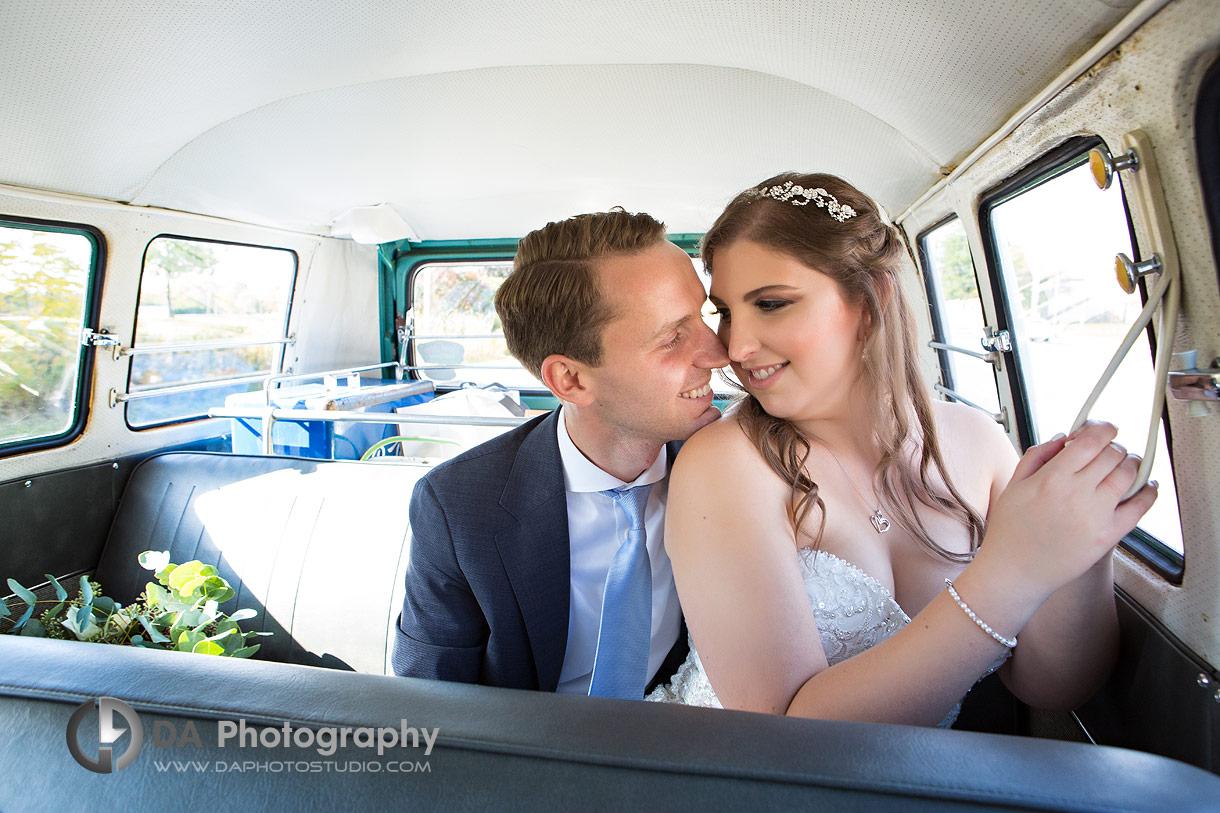 Bride and Groom in vintage Volkswagen van