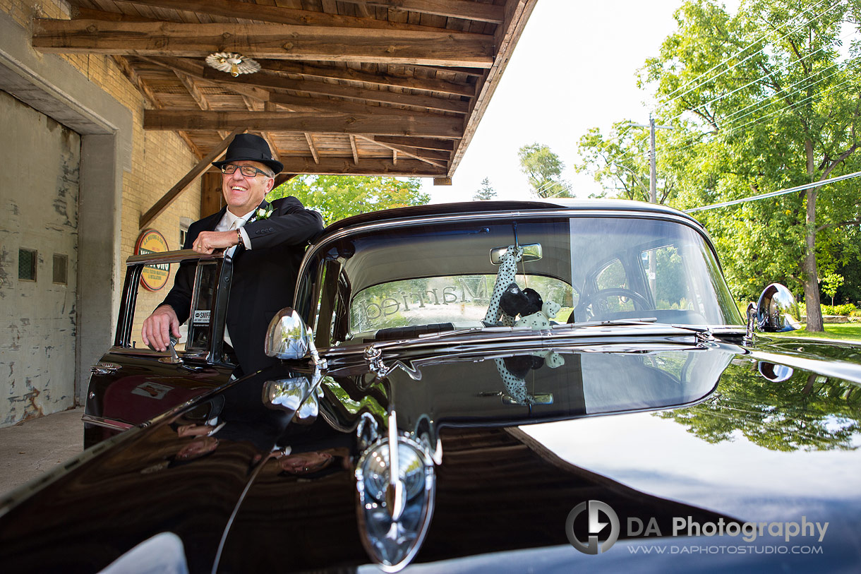 Groom with vintage car at Wilfong and Son LTD