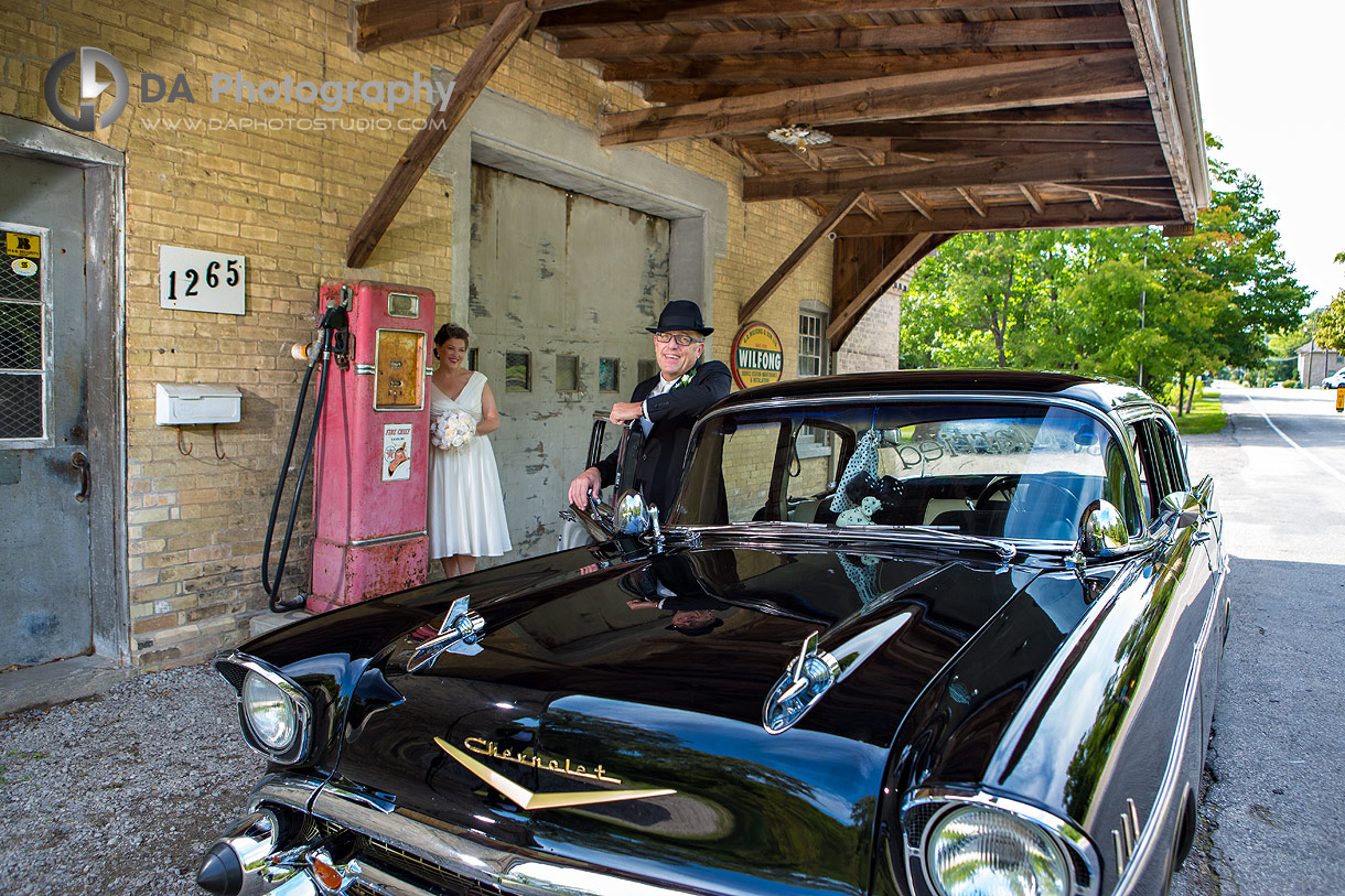 Bride and Groom with vintage car at Wilfong and Son LTD