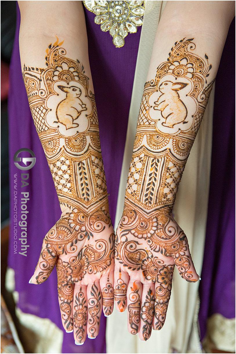 Bride's henna at pre-wedding ceremony