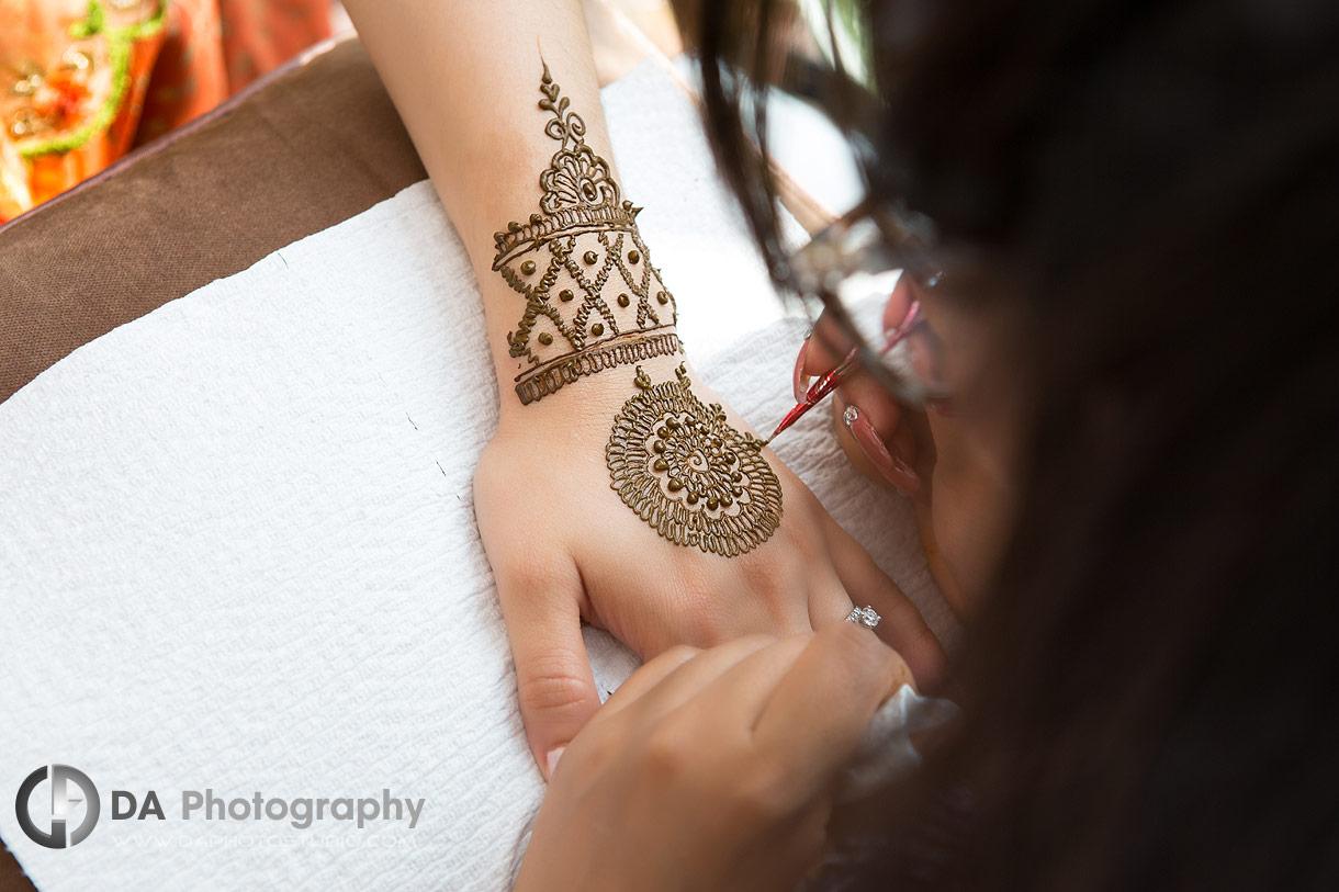 Henna artist during pre-wedding ceremony